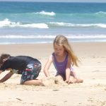 Children playing on British beach holiday
