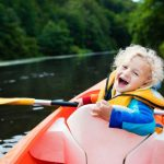 Little boy in kayak
