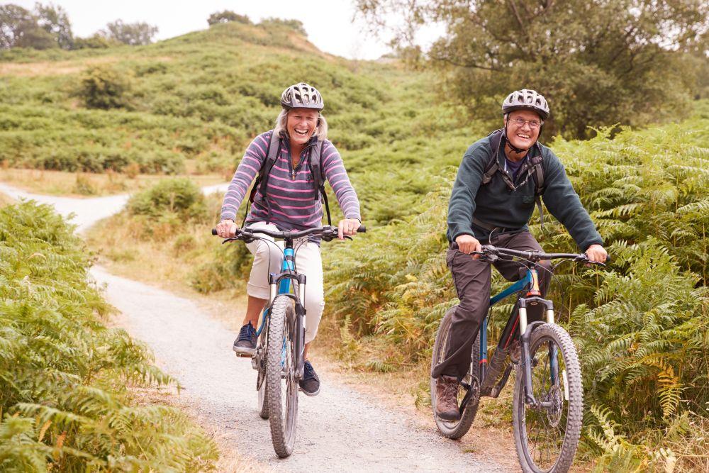 Older couple cycling on UK holiday