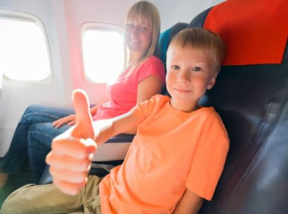 Child on a plane going on holiday