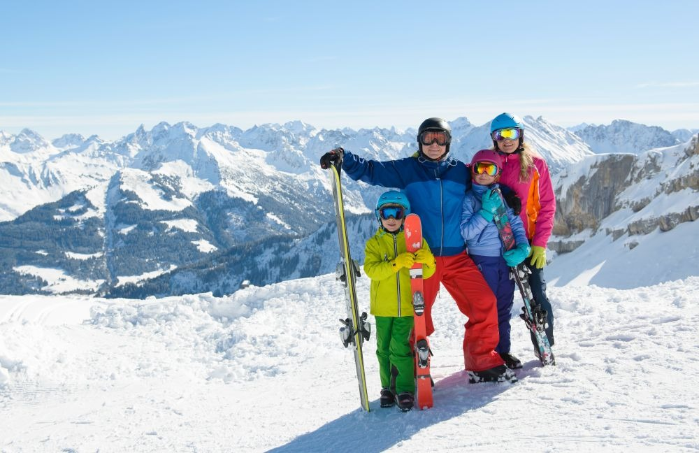 Happy family enjoying winter vacations in mountains.