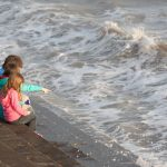 Children are looking at sea in UK