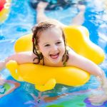Girl playing in swimming pool